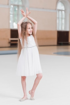 Portrait of cute girl dancing in dance class