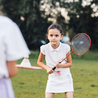 Portrait of a cute girl playing badminton