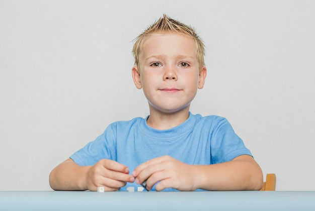 Portrait of cute kid with blonde hair