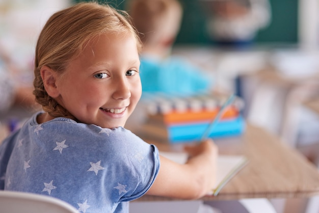 Portrait of cute little girl during the lesson
