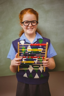 Portrait of cute little girl holding abacus