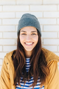 Portrait of cute lovely woman wearing knitted hat and jacket