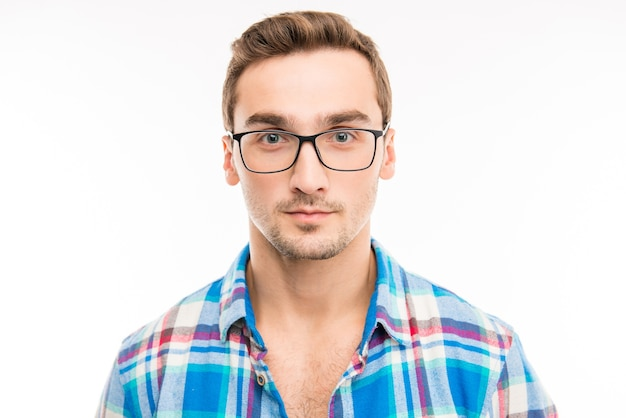Portrait of cute quiet serious man in glasses