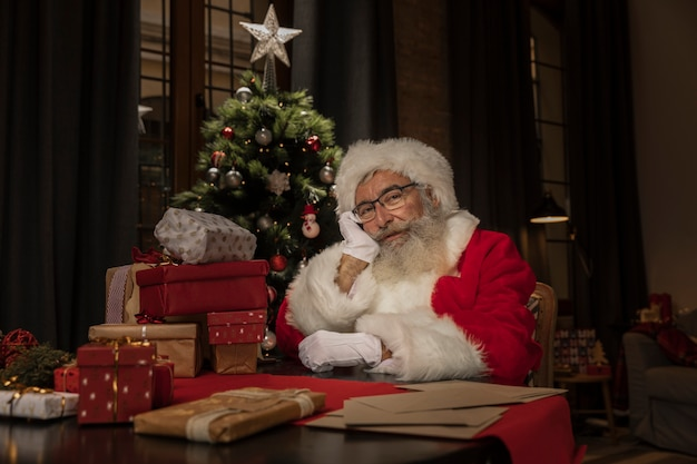 Portrait of cute santa claus thinking