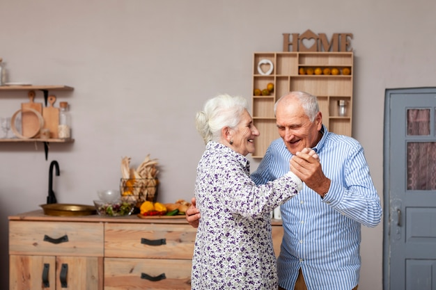Portrait of cute senior couple dancing