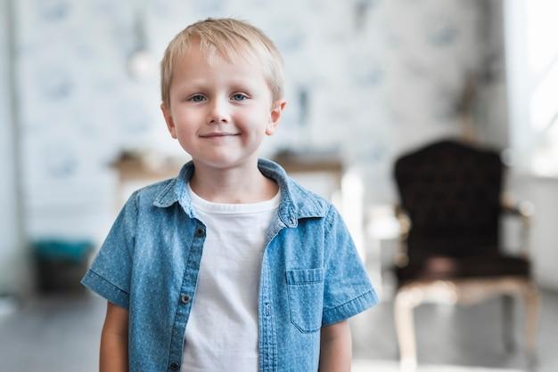 Portrait of a cute smiling blonde boy