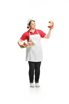Portrait of cute smiling woman with pastries in her hands