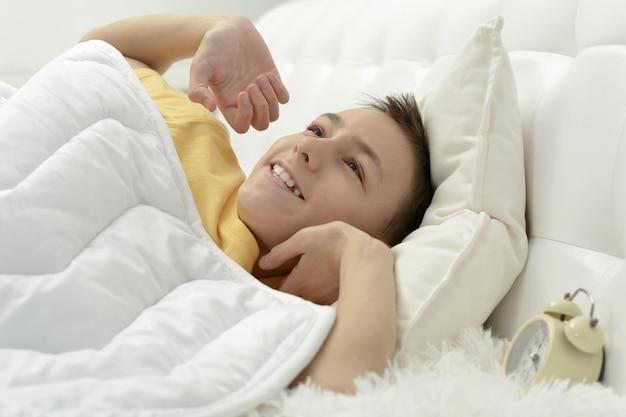 Portrait of a cute waking up boy