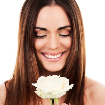 Portrait of cute woman with white rose