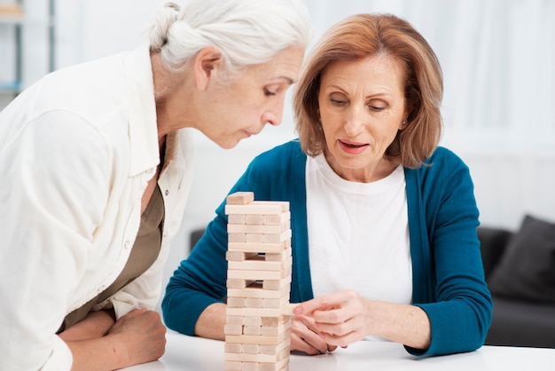 Portrait of cute women playing jenga