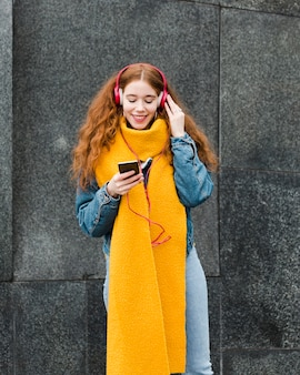 Portrait of cute young girl listening to music