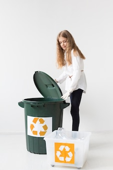Portrait of cute young girl recycling