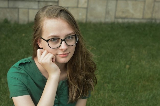 Portrait of cute young girl with eyeglasses