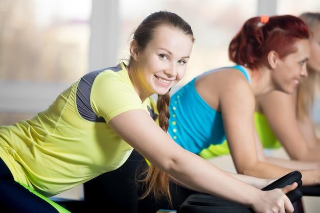 Portrait of cyclist woman in gym