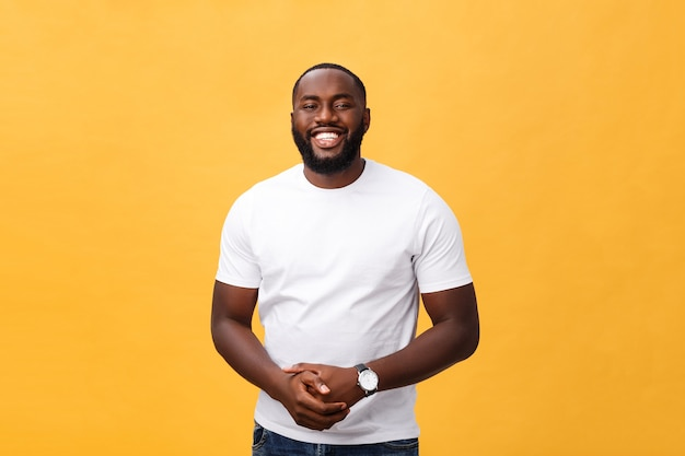 Portrait of delighted african american male with positive smile