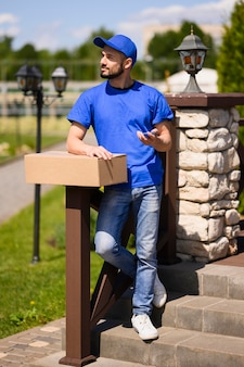 Portrait of delivery man waiting for customer