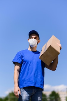 Portrait of delivery man wearing face mask