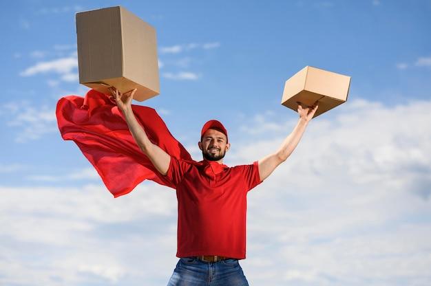 Portrait of delivery man wearing superhero cape