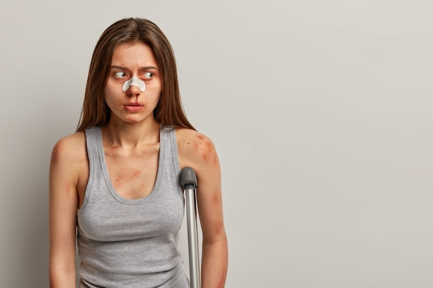 Portrait of disabled handicapped woman has workplace accident