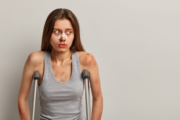 Portrait of displeased woman suffers accident looks aside