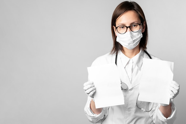 Portrait of doctor holding blank papers