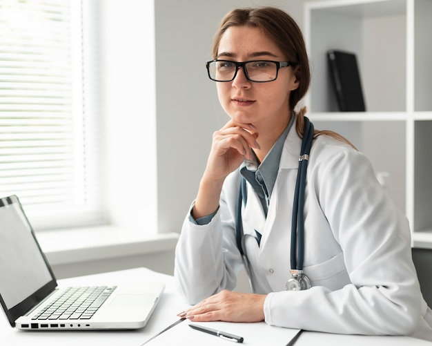 Portrait of doctor posing with stethoscope