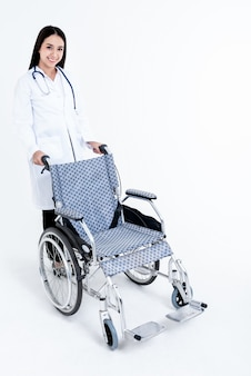 Portrait of doctor pushing the weelchair