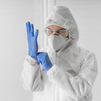 Portrait of a doctor wearing a face mask and surgical gloves