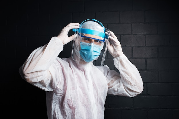 Portrait of a doctor wearing ppe suit against coronavirus and covid-19