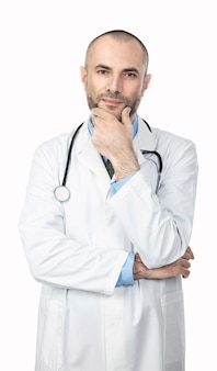 Portrait of a doctor with a beard and a white coat with a calm and positive expression.