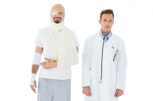 Portrait of a doctor with patient tied up in bandage
