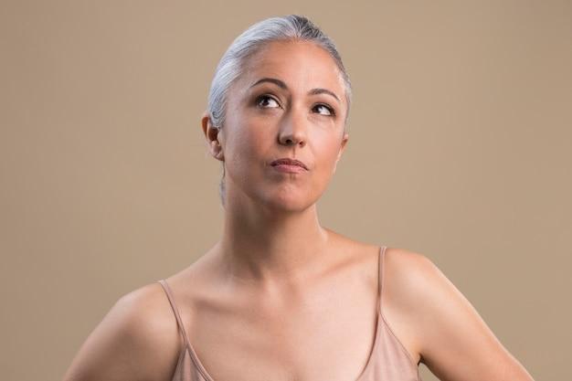 Portrait of doubtful older woman
