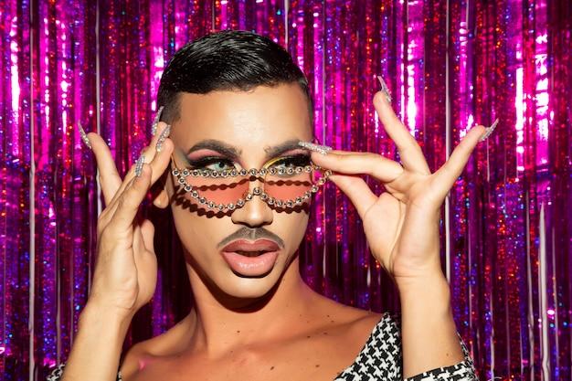 Portrait of drag queen diva in glitter night