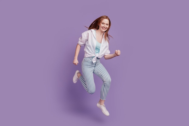 Portrait of dreamy careless lady jump run hurry shopping concept on violet background