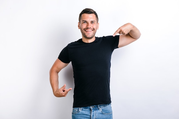 Portrait of egoistic arrogant selfish man with beard pointing at himself, boasting successful achievement, feeling proud and supercilious. indoor studio shot, white background