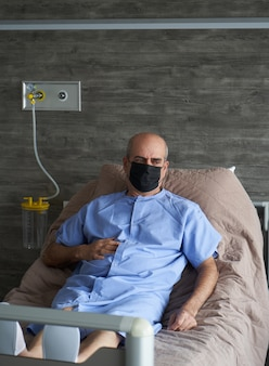 Portrait of an elderly man in hospital bed, close-up