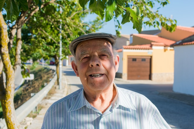 Portrait of a elderly man on the street of a town