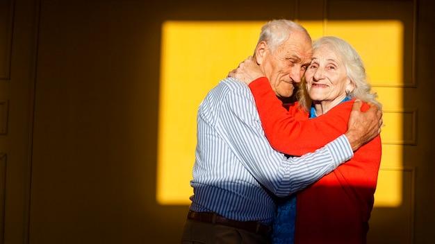 Portrait of elderly man and woman hugging