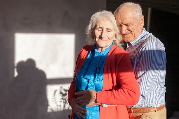 Portrait of elderly man and woman in love