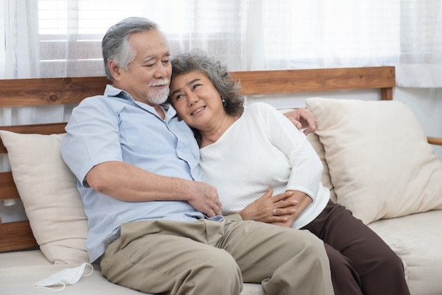 Portrait of elderly senior asian couple happy together at home.