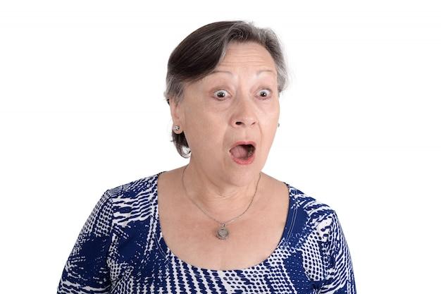 Portrait of elderly woman shocked.