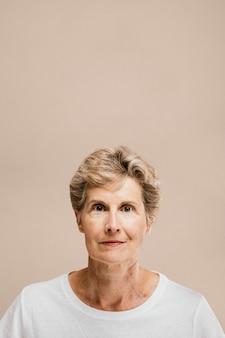 Portrait of an elderly woman in a white tee