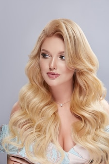 Portrait of elegant blond with long hair looking to the side