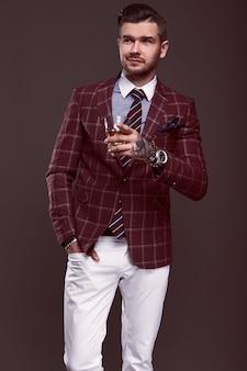 Portrait of elegant brutal man in a expensive suit