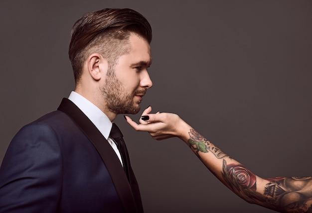 Portrait of elegant brutal man in a suit