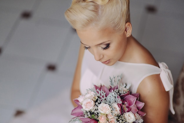 Portrait of an elegant fashion model girl bride blonde in a delicate dress