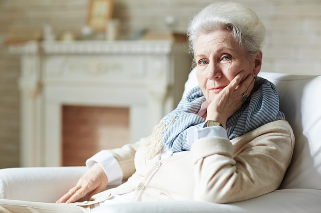 Portrait of elegant-looking elderly woman