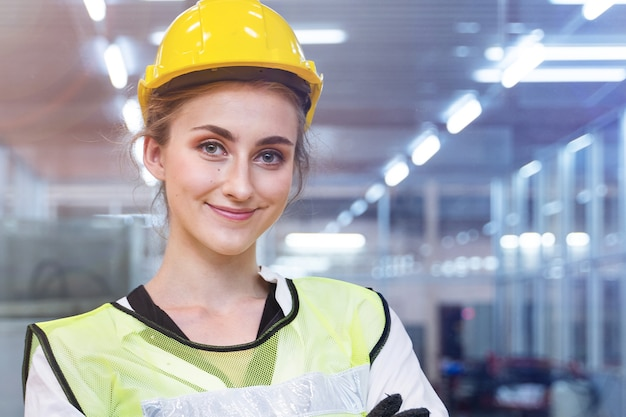 Portrait of engineer beautiful woman worker is standing with confident