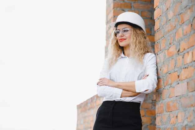 A portrait of engineer woman looking construction. concept engineer and business work.