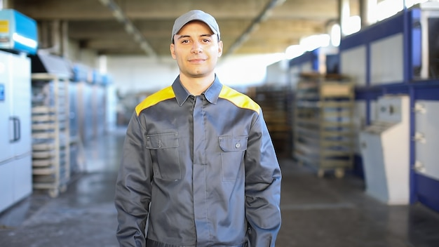 Portrait of an engineer at work in a factory